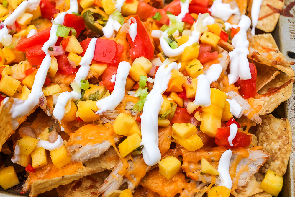 pulled pork nachos with pineapple, mango and sour cream