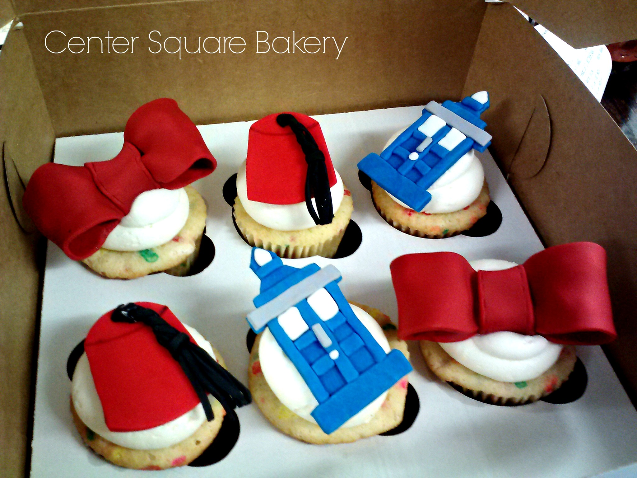 cupcakes with Dr. Who fondant toppers