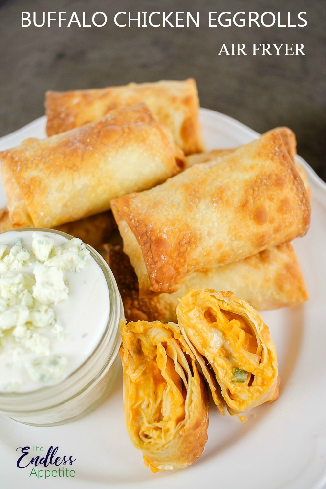 white plate with buffalo chicken egg rolls made in air fryer with blue cheese dressing