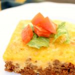 white plate with a slice of bacon cheeseburger low carb casserole