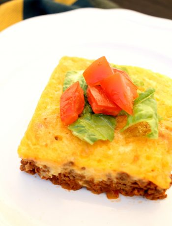 slice of low carb bacon cheeseburger keto casserole on a white plate