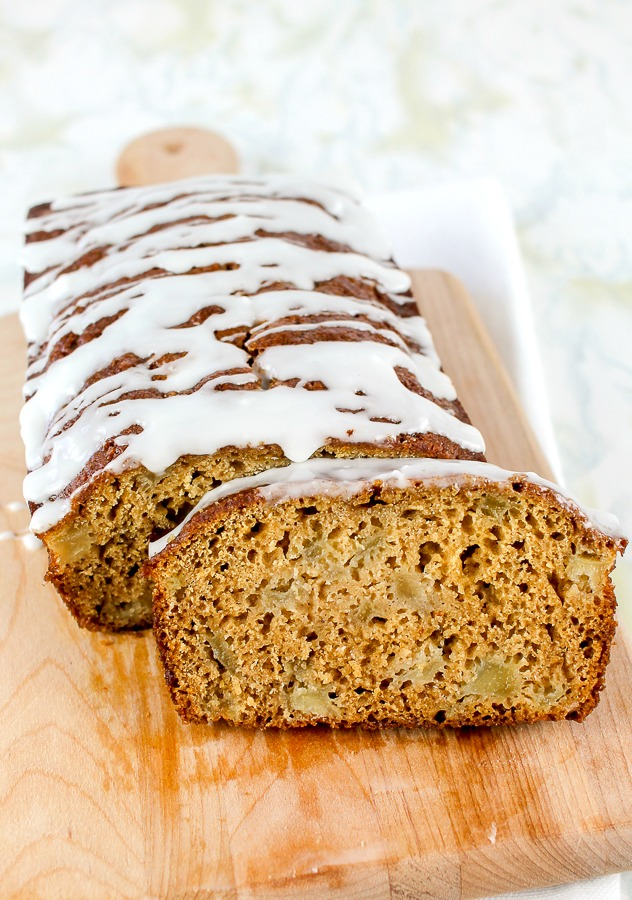 wooden cutting board with easy pear quick bread sliced