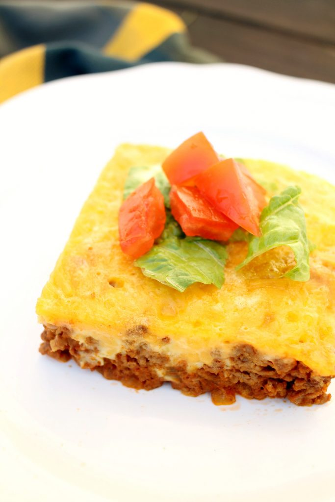 white plate with low carb bacon cheeseburger keto casserole