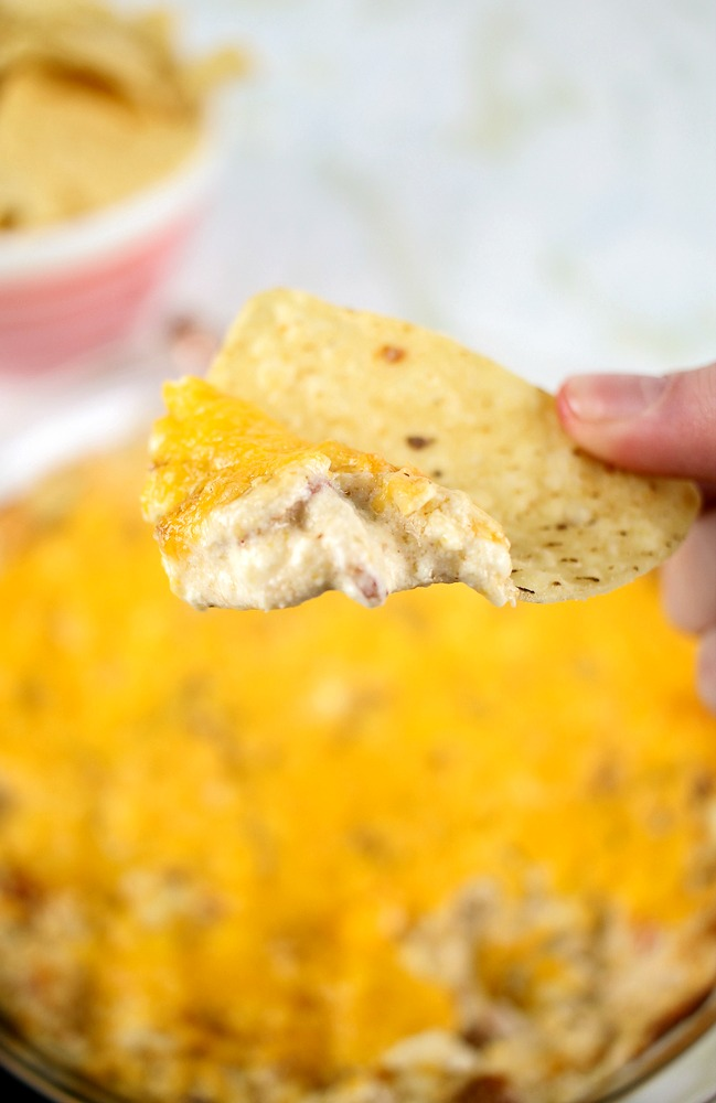 tortilla chip with a scoop of hot shrimp and bacon dip for a keto appetizer