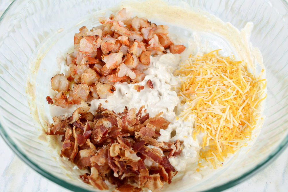 bowl with bacon, shrimp, cheese ingredients for hot bacon shrimp dip