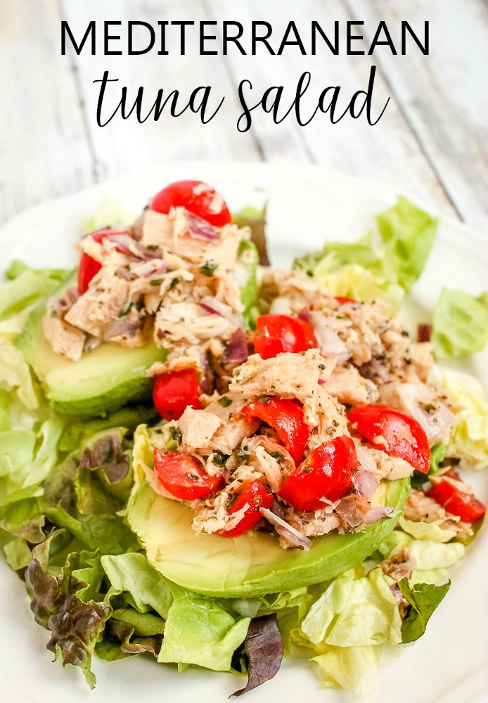 Mediterranean tuna salad with tomatoes in an avocado