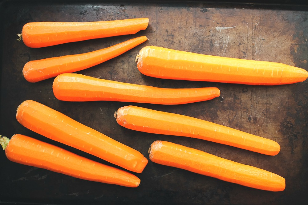 whole carrots on a cookie sheet
