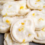 a pile of lemon short bread cookies with lemon icing