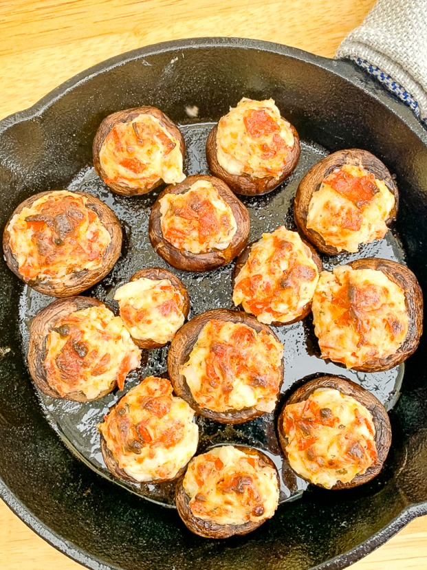 pizza stuffed mushrooms in a cast iron skillet