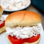 a chicken salad sandwich with tomatoes