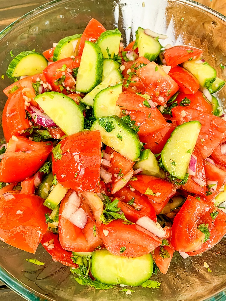 an up close shot of tomato and cucumber salad