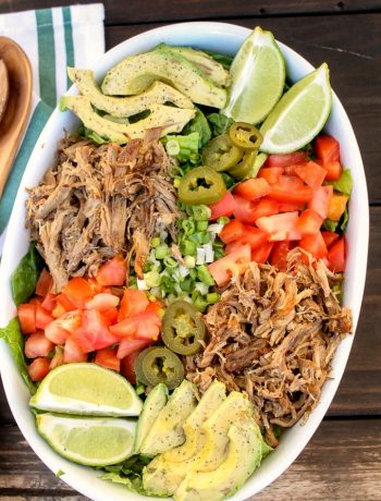 white oval dish filled with pressure cooker pork carnita and Mexican salad ingredients