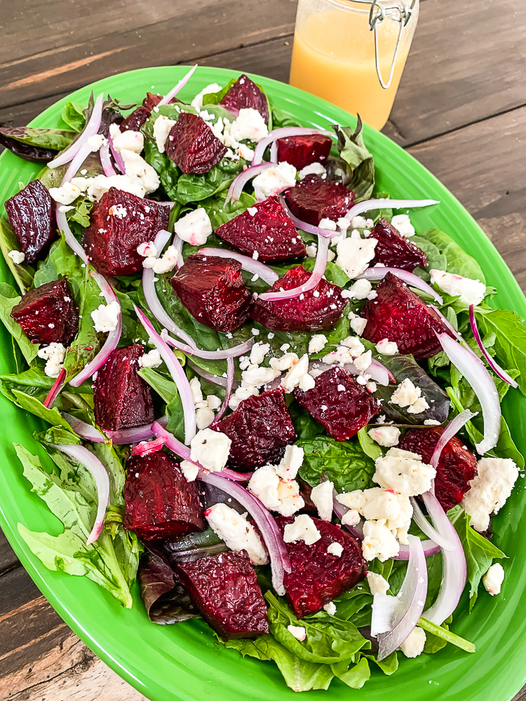 green platter with roast beetroot salad with feta