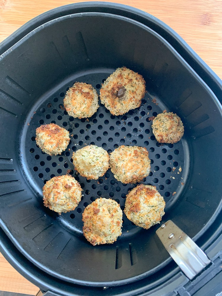 air fryer basket with fried mushrooms
