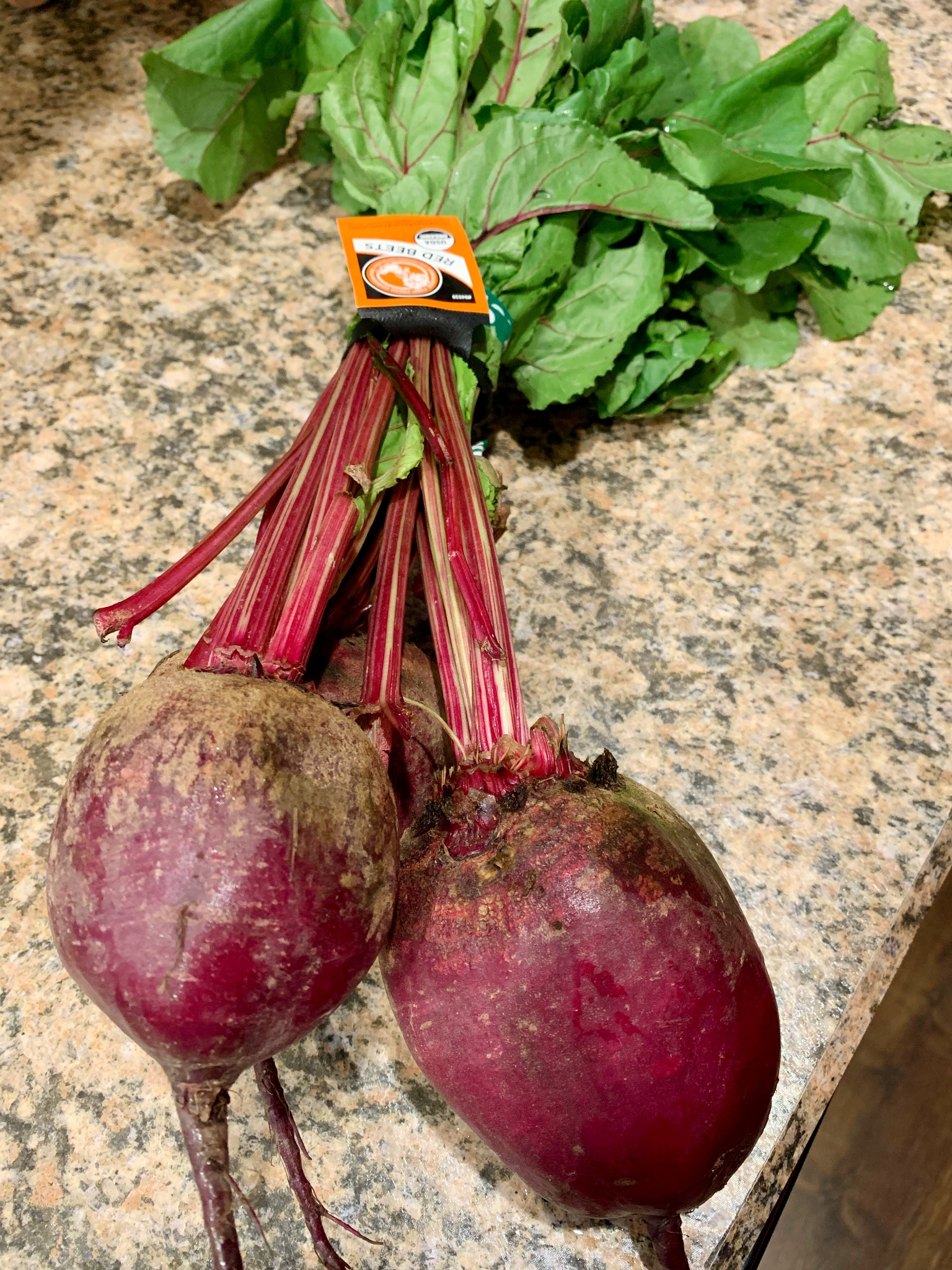 3 large beets with stems and leaves still attached