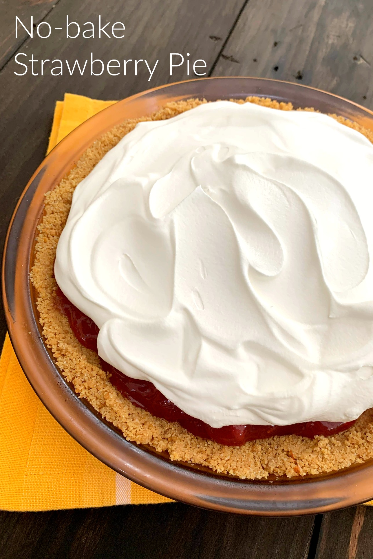 glass pie plate with no bake strawberry pie covered in cool whip