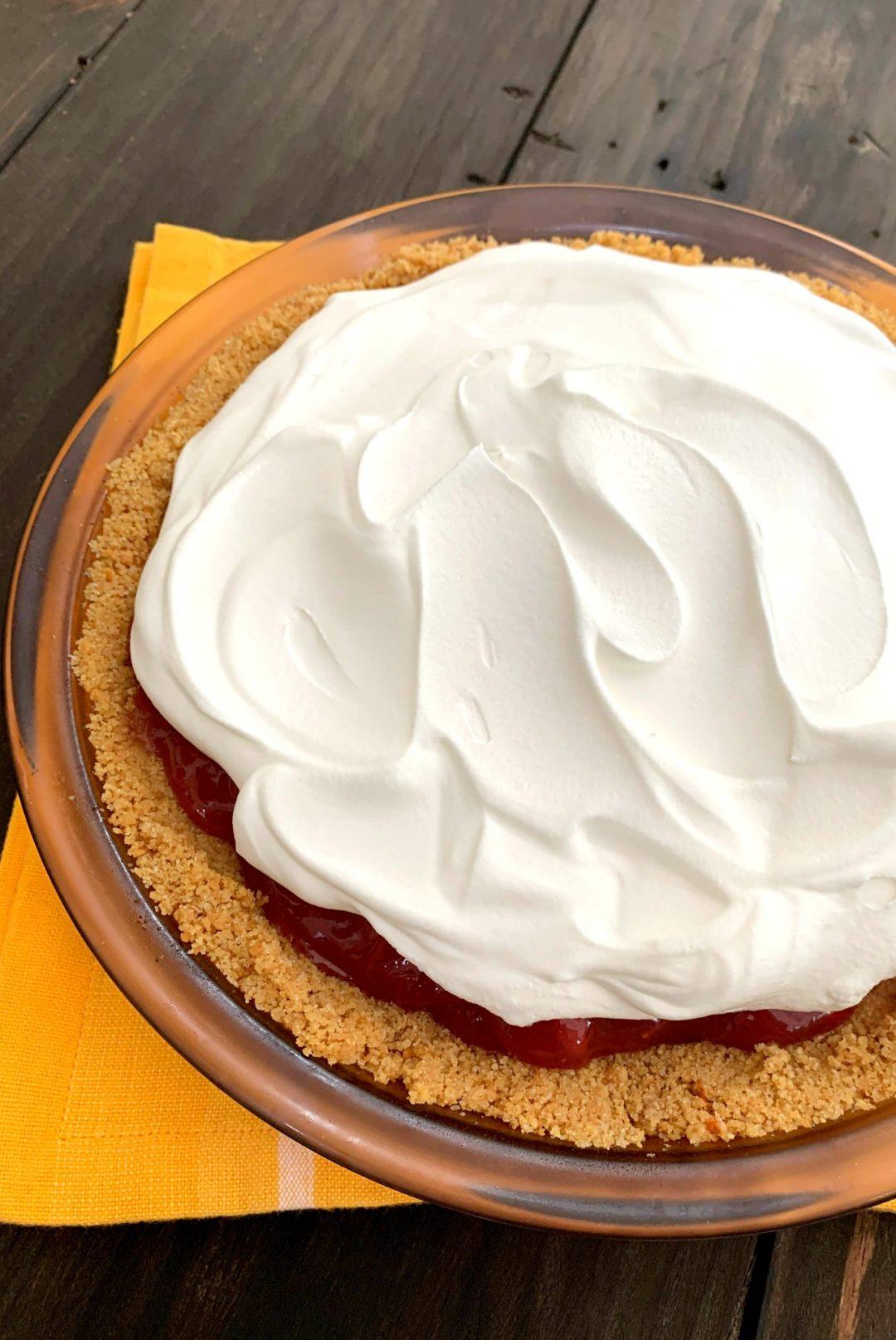 glass pie dish with homemade no bake strawberry pie