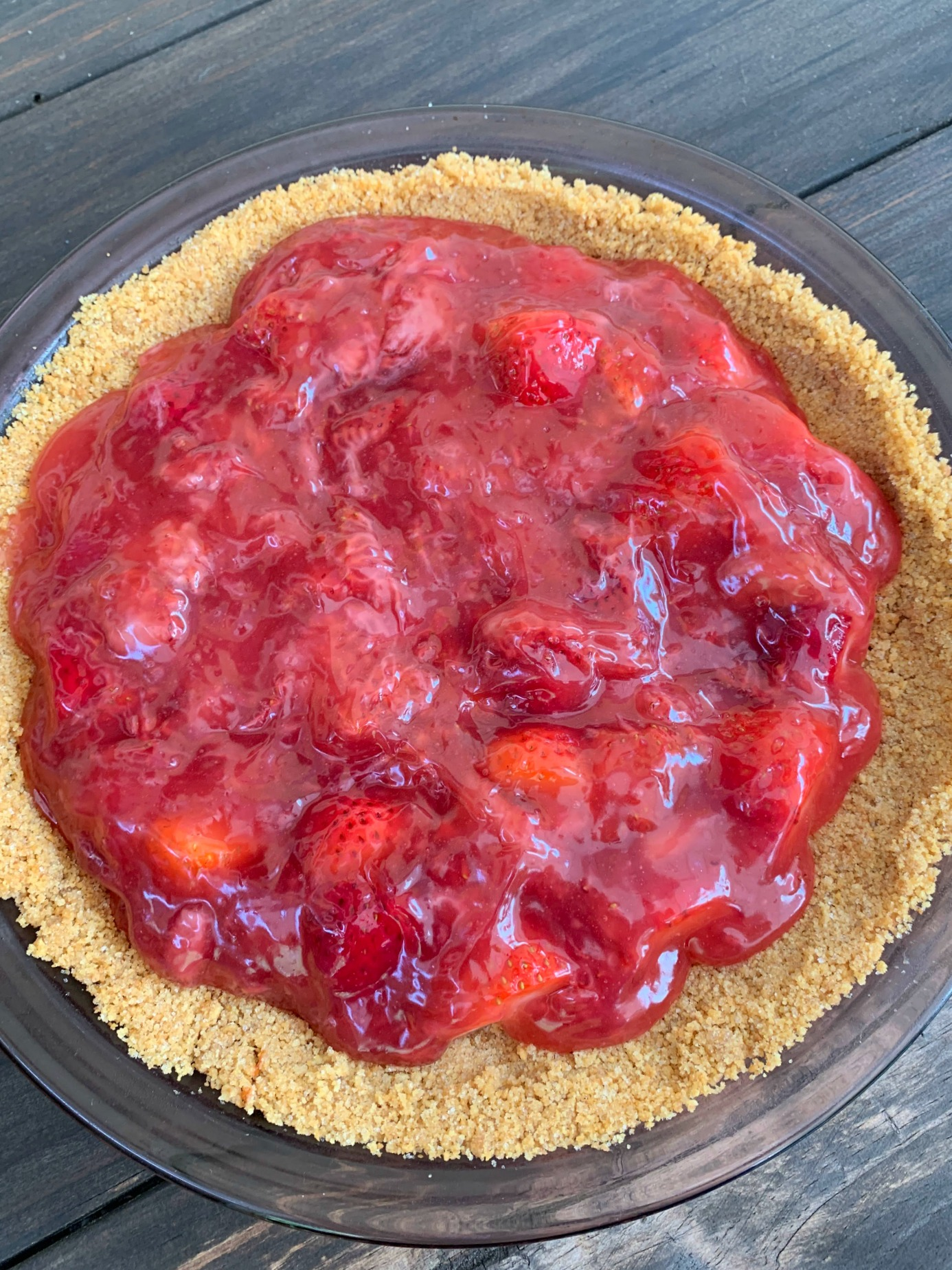 graham cracker crust filled with a homemade strawberry pie filling