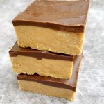 3 peanut butter chocolate bars stacked on top of each other