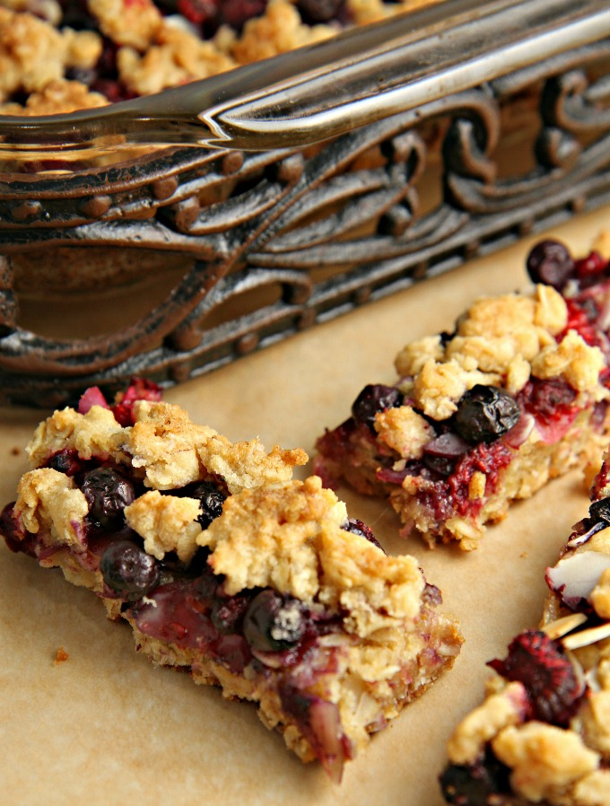 2 slices of berry crumb bars with the pan in the background