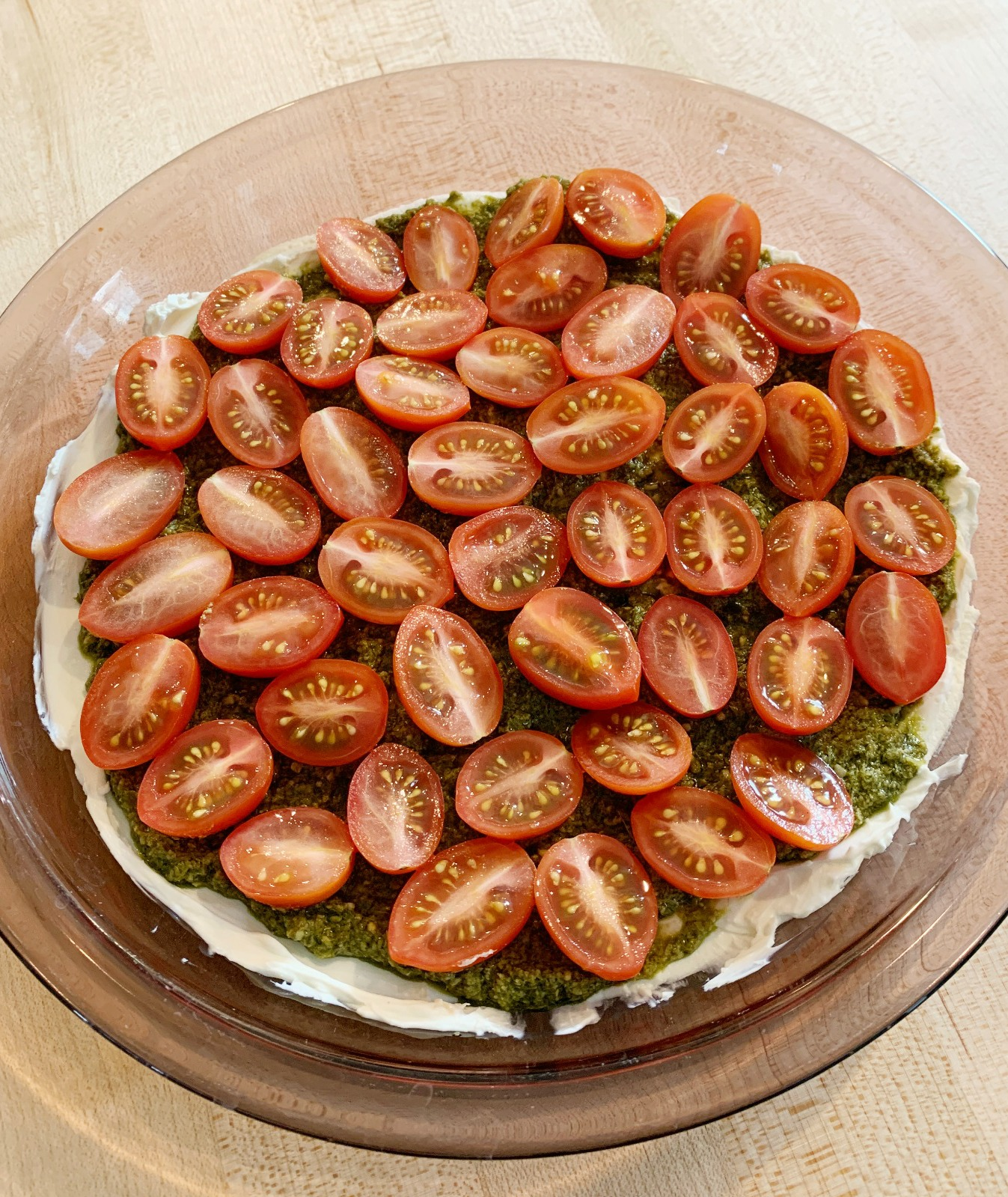 pie dish with caprese dip before it's baked
