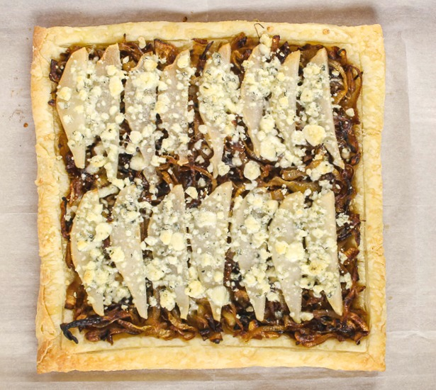 overhead shot of the entire puff pastry sheet with onions, pears and gorgonzola