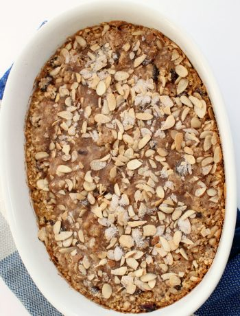 white oval casserole dish with cranberry almond baked oatmeal