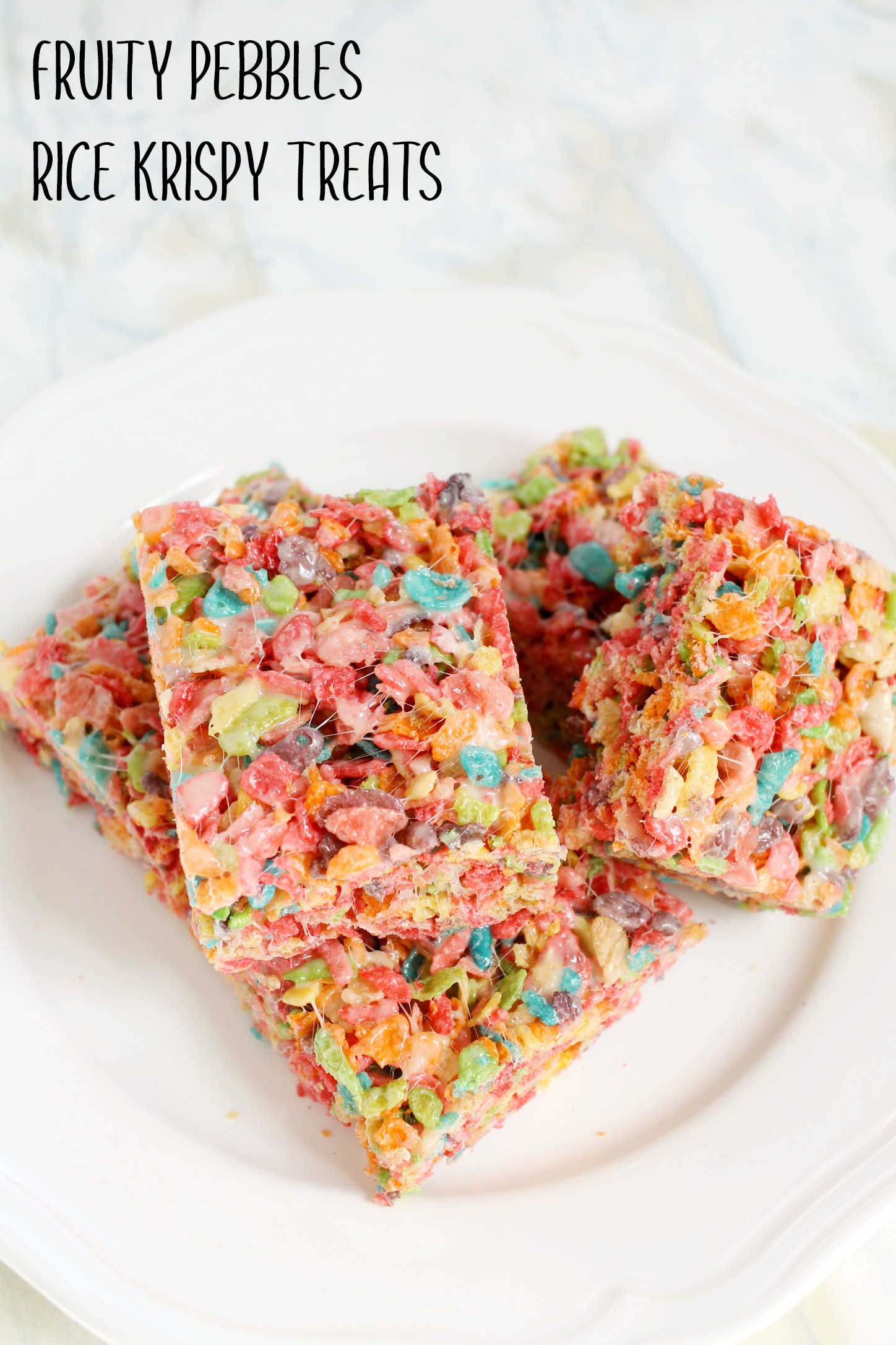 white plate with squares of fruity pebbles rice krispies