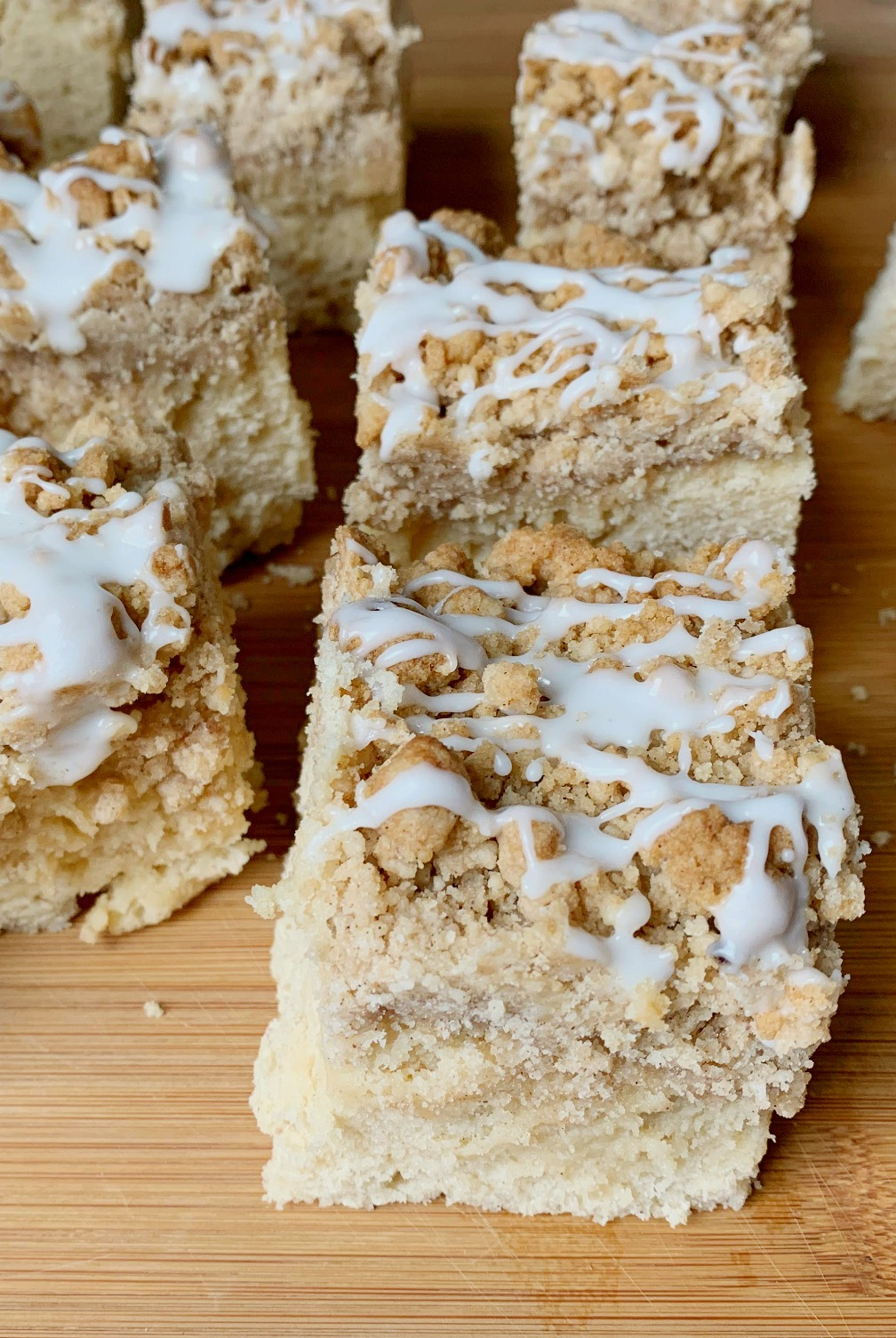 up close shot of a slice of New York Crumb Coffee Cake to show the glaze on top