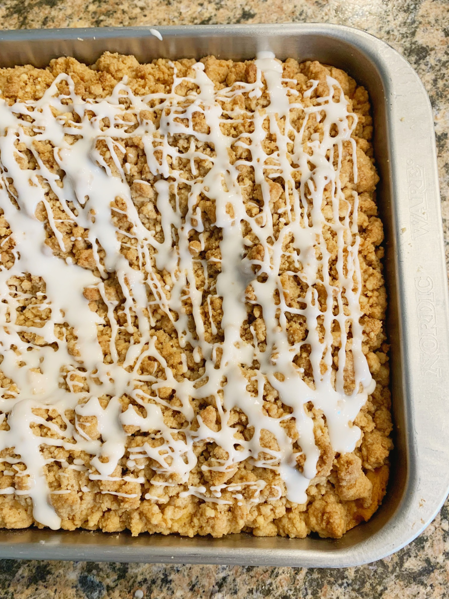 up close shot of the finished coffee cake still in the pan
