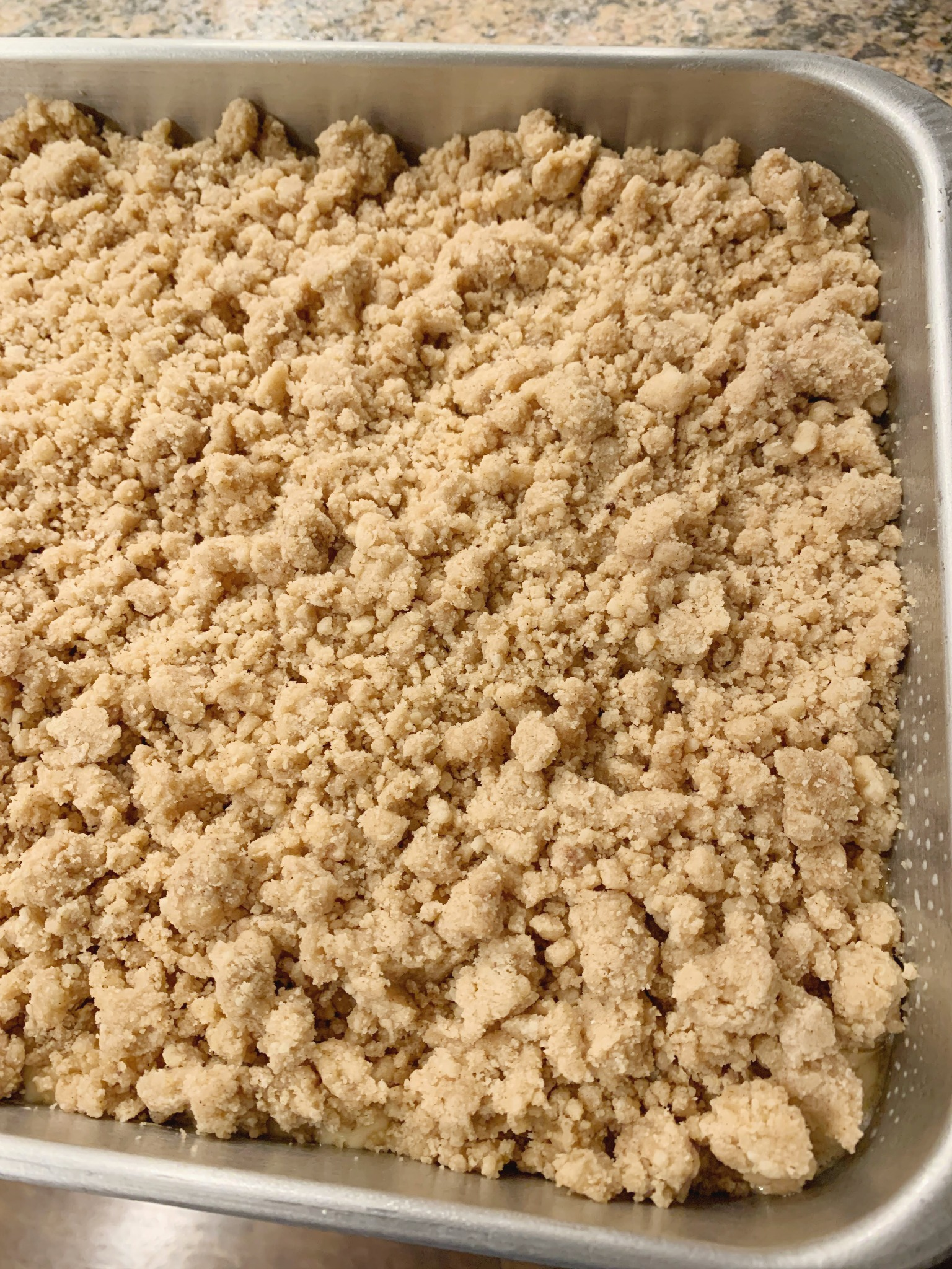 the crumbs on top of the batter before it is baked