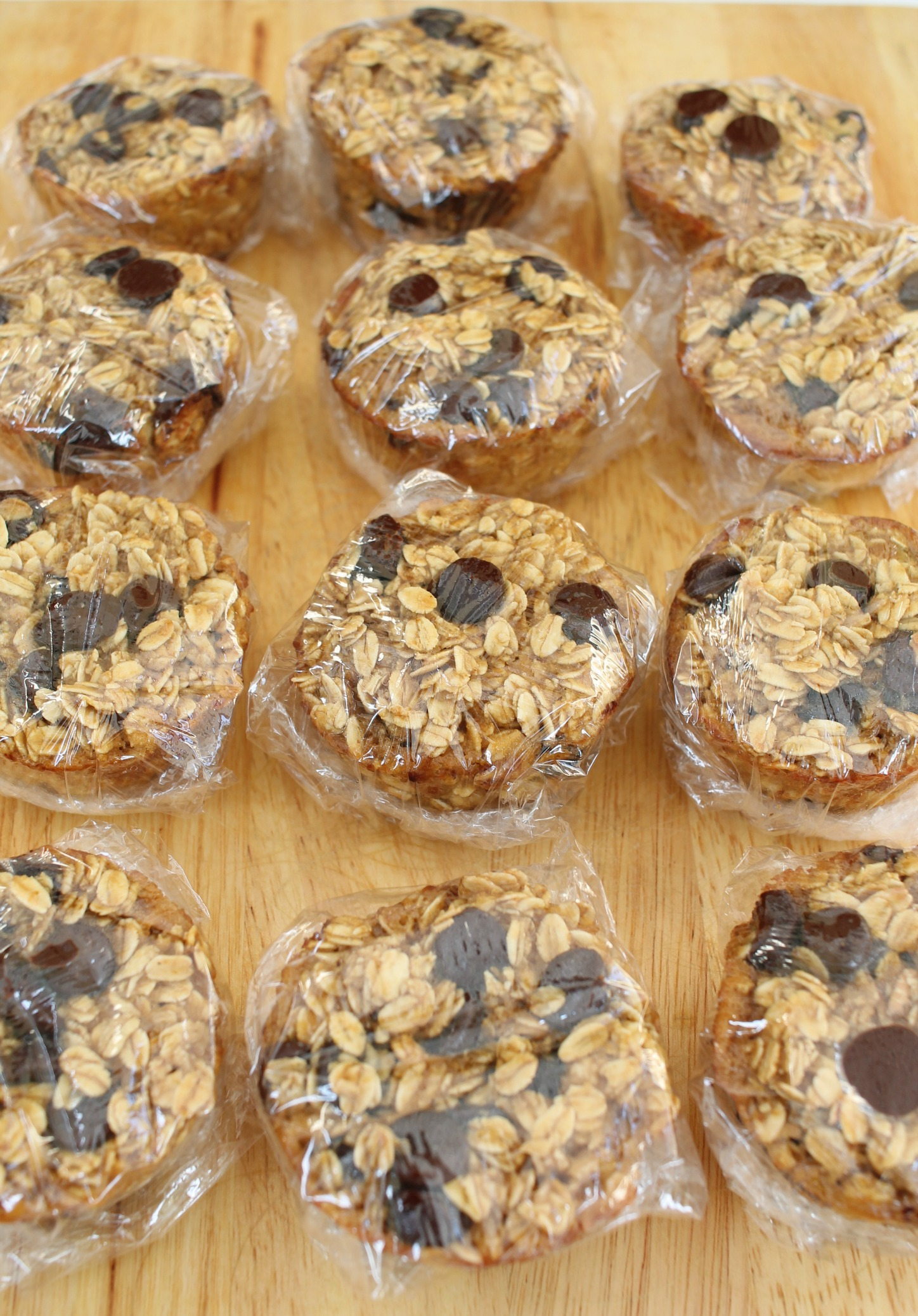peanut butter chocolate chip baked oatmeal muffins that are individually wrapped in plastic wrap