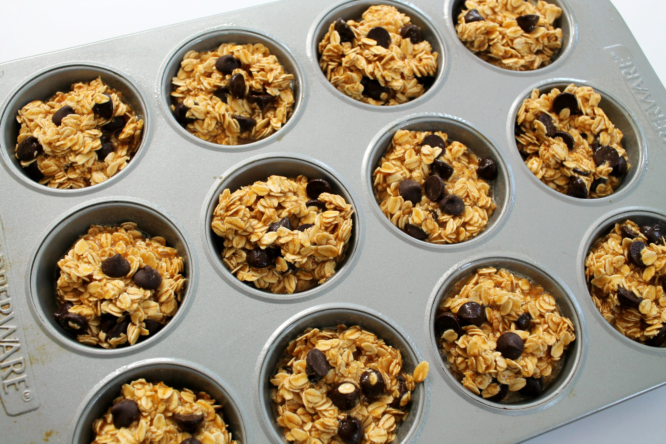 peanut butter chocolate chip baked oatmeal muffins in the muffin pan before baking