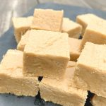 squares of peanut butter fudge up close on a piece of slate