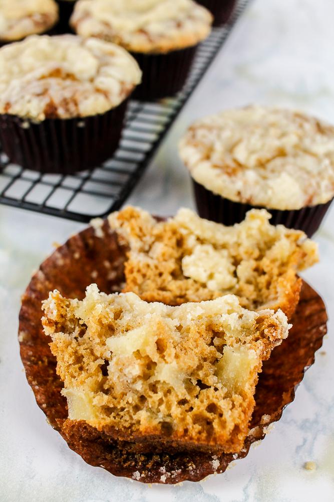 a pear muffin cut in half in a brown cupcake liner