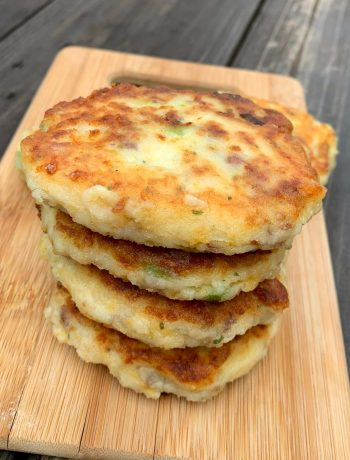 potato pancakes in a stack on a wooden cutting board