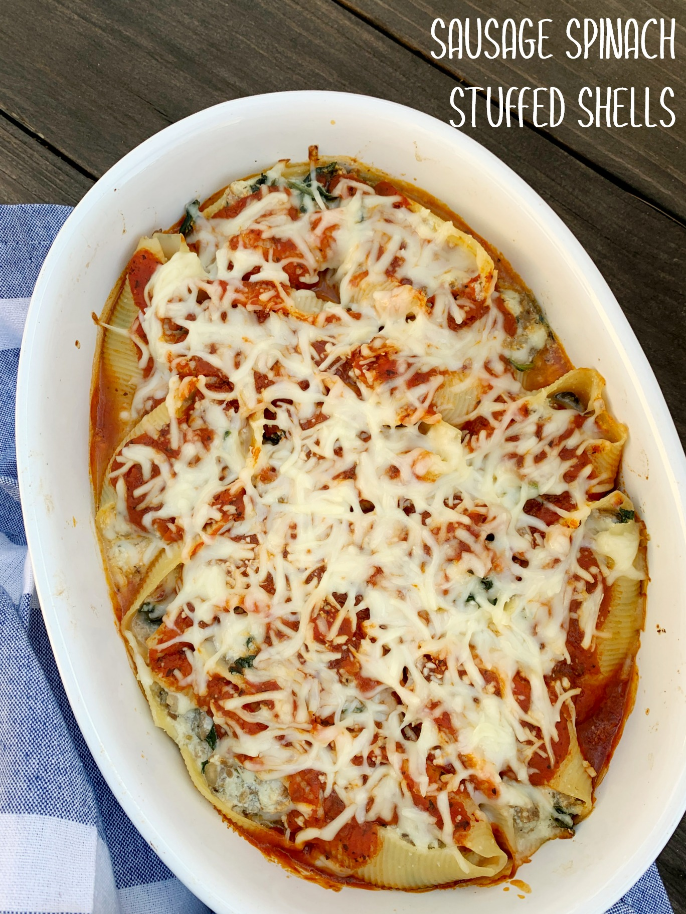 white oval dish with stuffed shells after baking