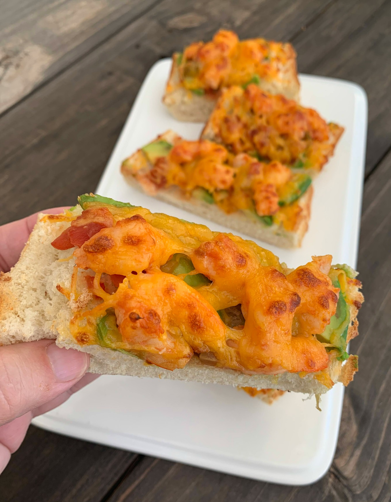 slices of shrimp and avocado french bread