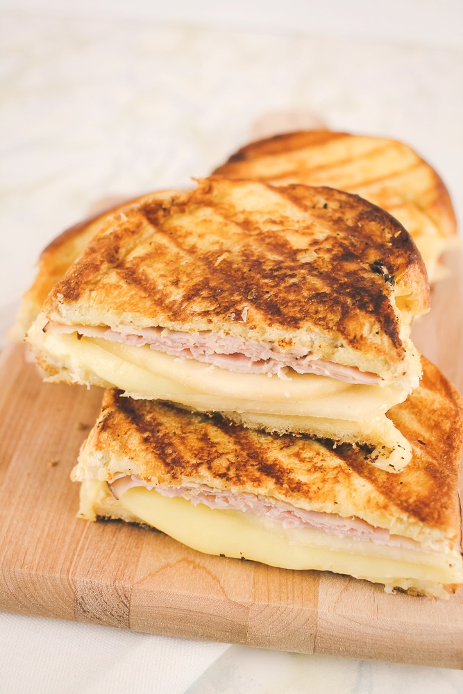 three halves of grilled ham, cheese and pear sandwiches