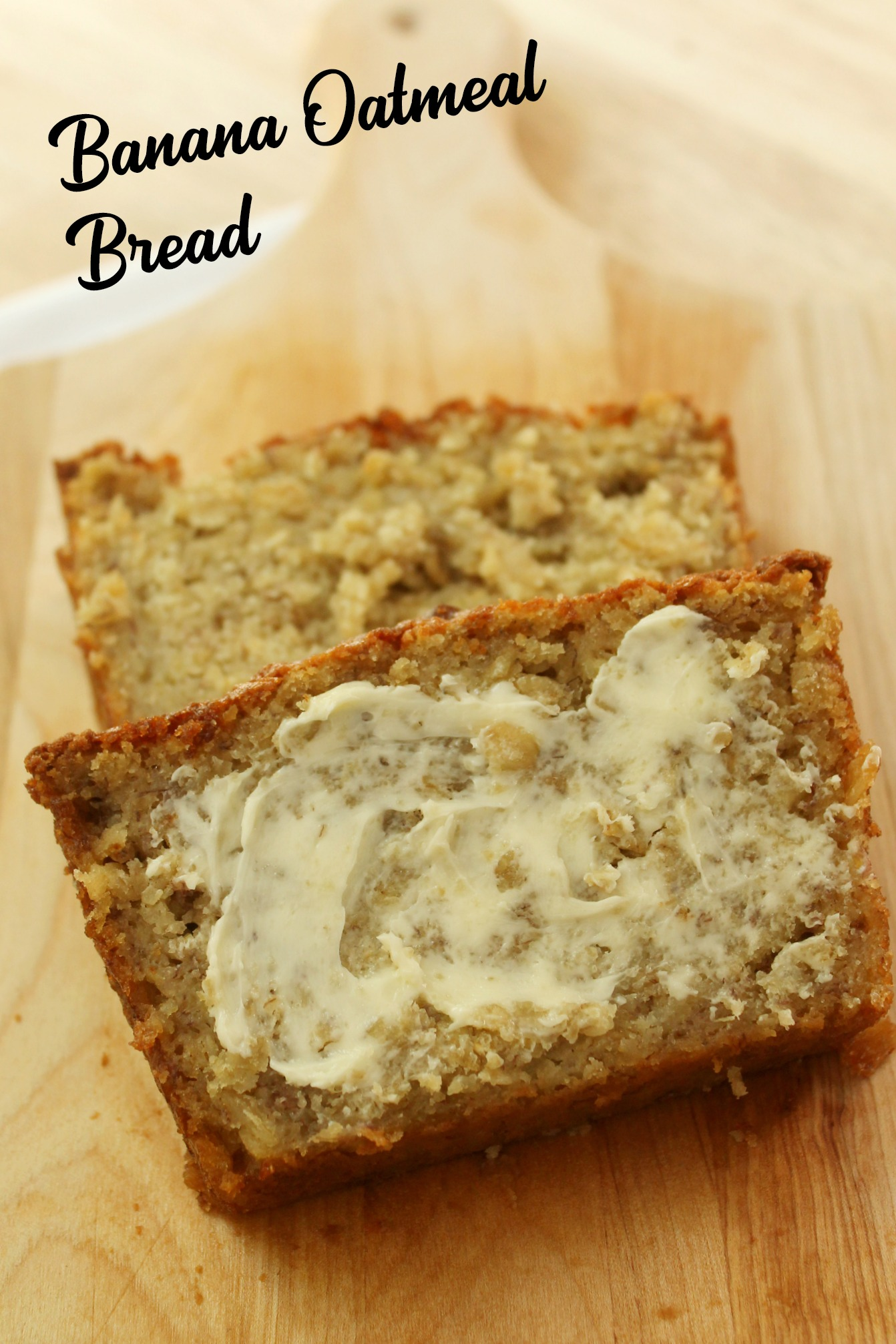 two slices of banana oatmeal bread with the top one buttered