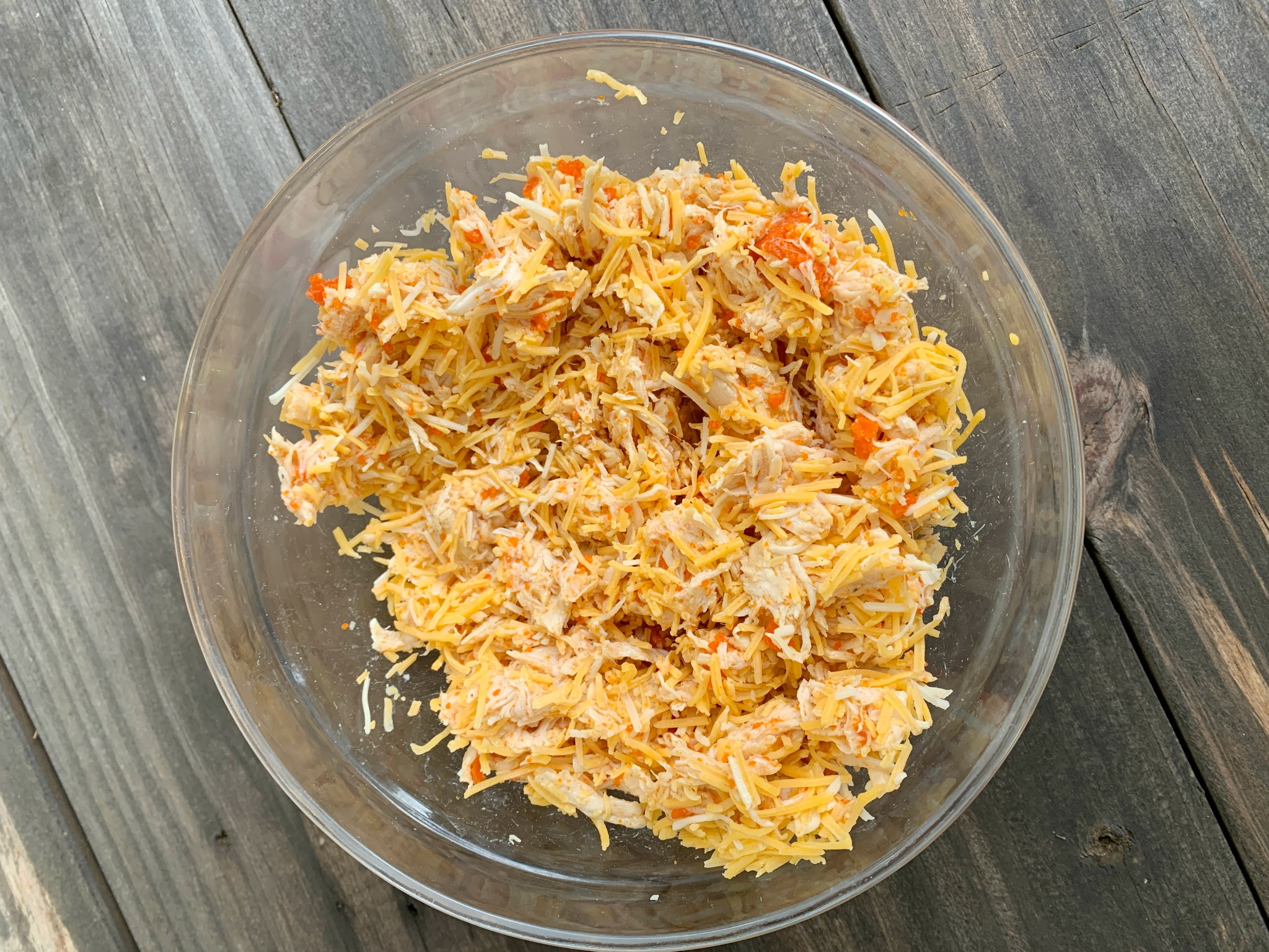 glass bowl with buffalo chicken mixture