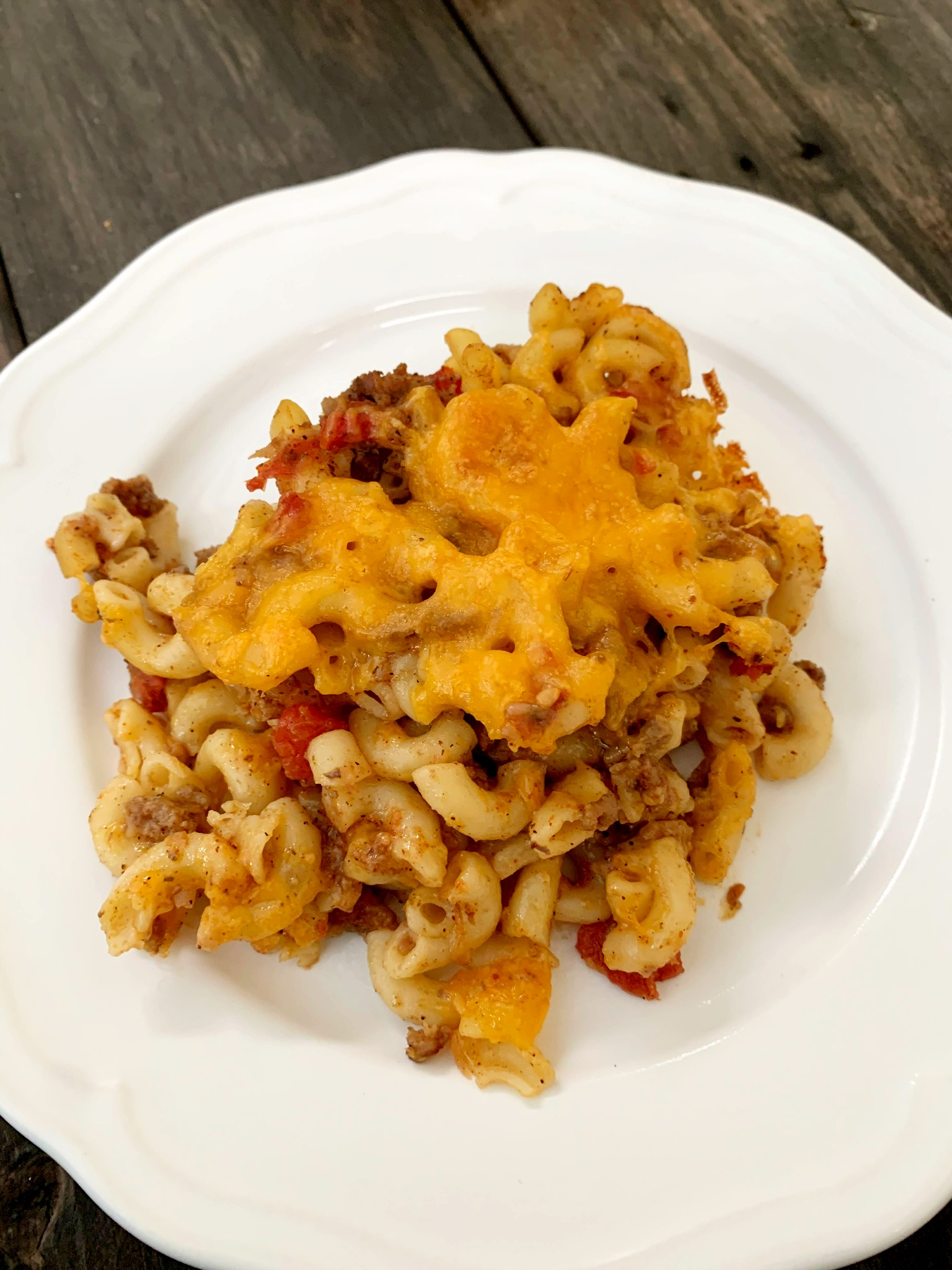 scoop of chili mac casserole on a white plate