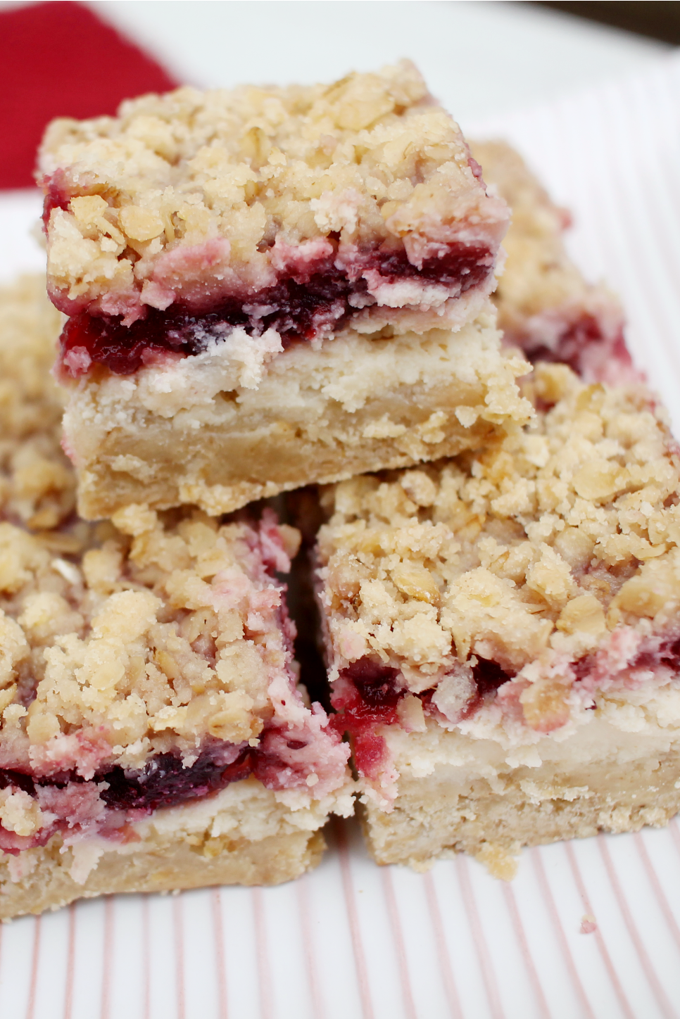 squares of Cranberry Cheese Bars piled on top of each other