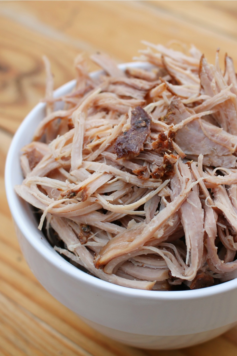 white bowl filled with pulled pork
