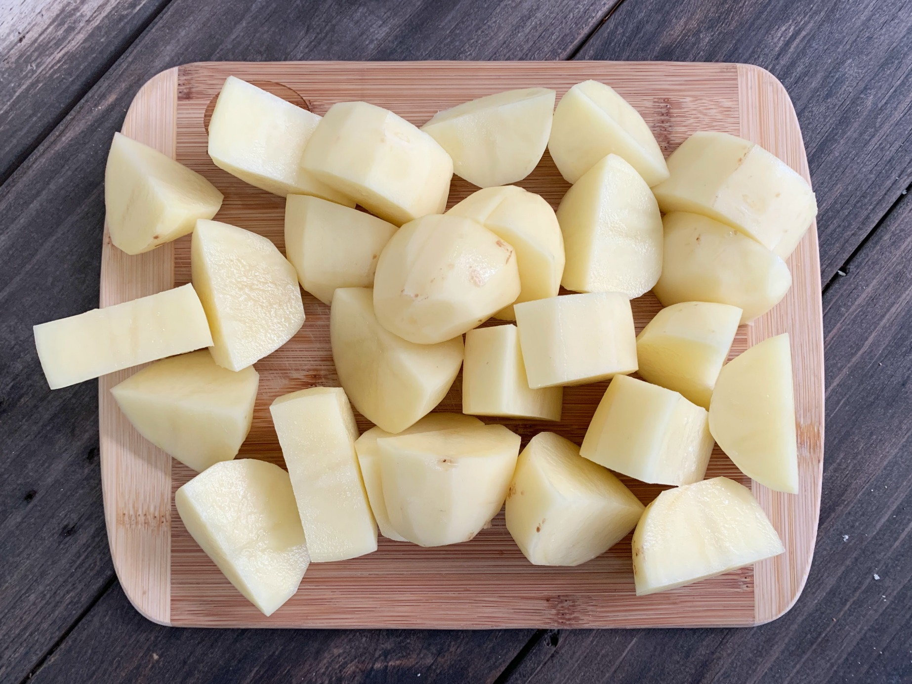 chopped potatoes on a wooden cutting board