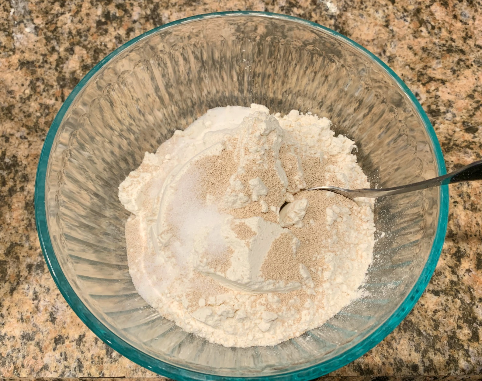 pizza dough ingredients in a bowl