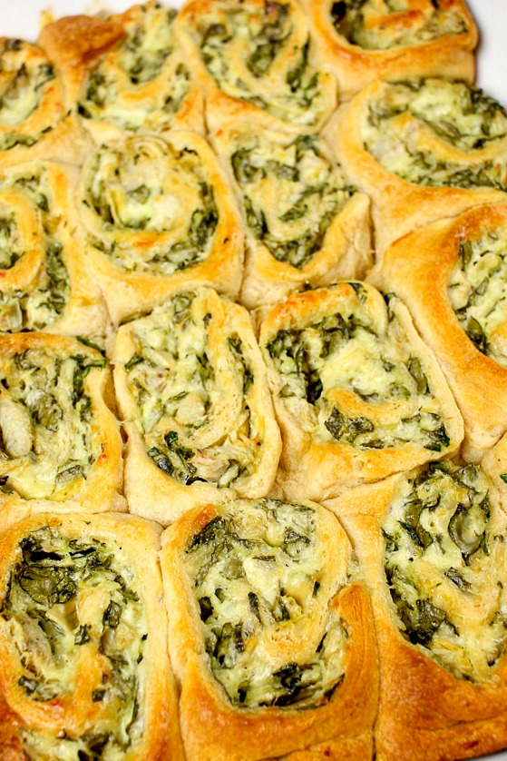 up close shot of Spinach and Artichoke Crescent Rolls in a white pan
