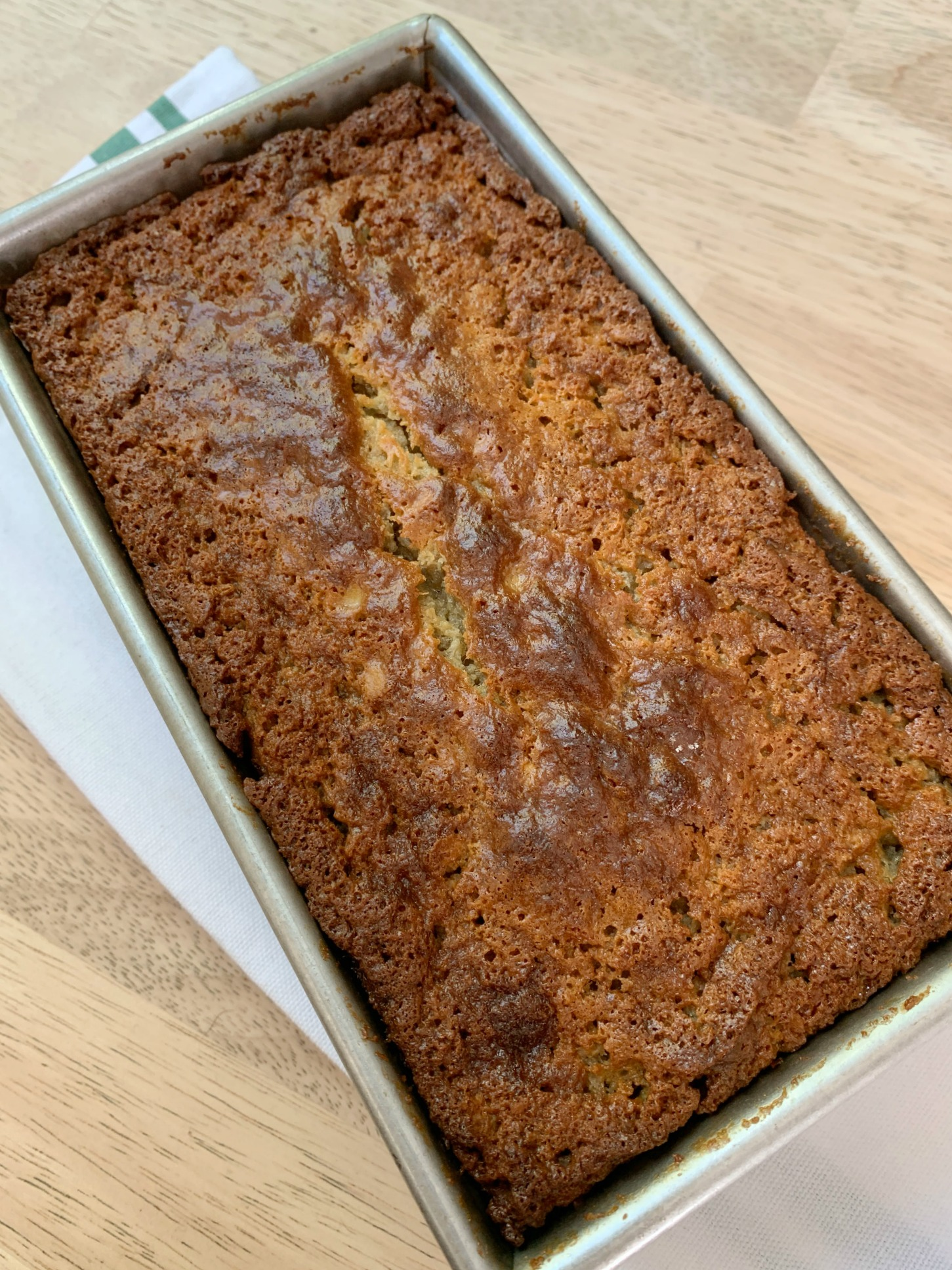 a loaf of banana oatmeal bread in the pan