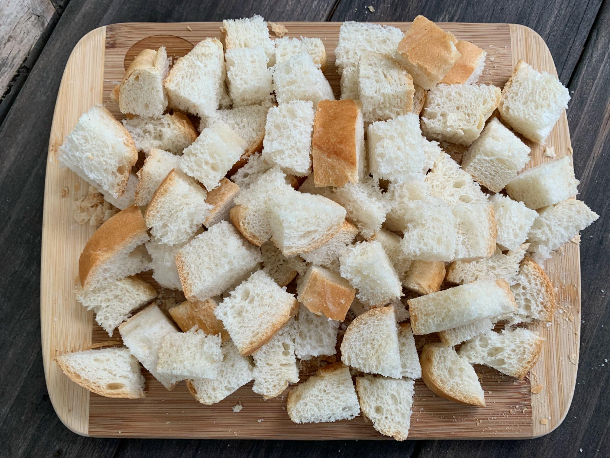 bread cubes on cutting board