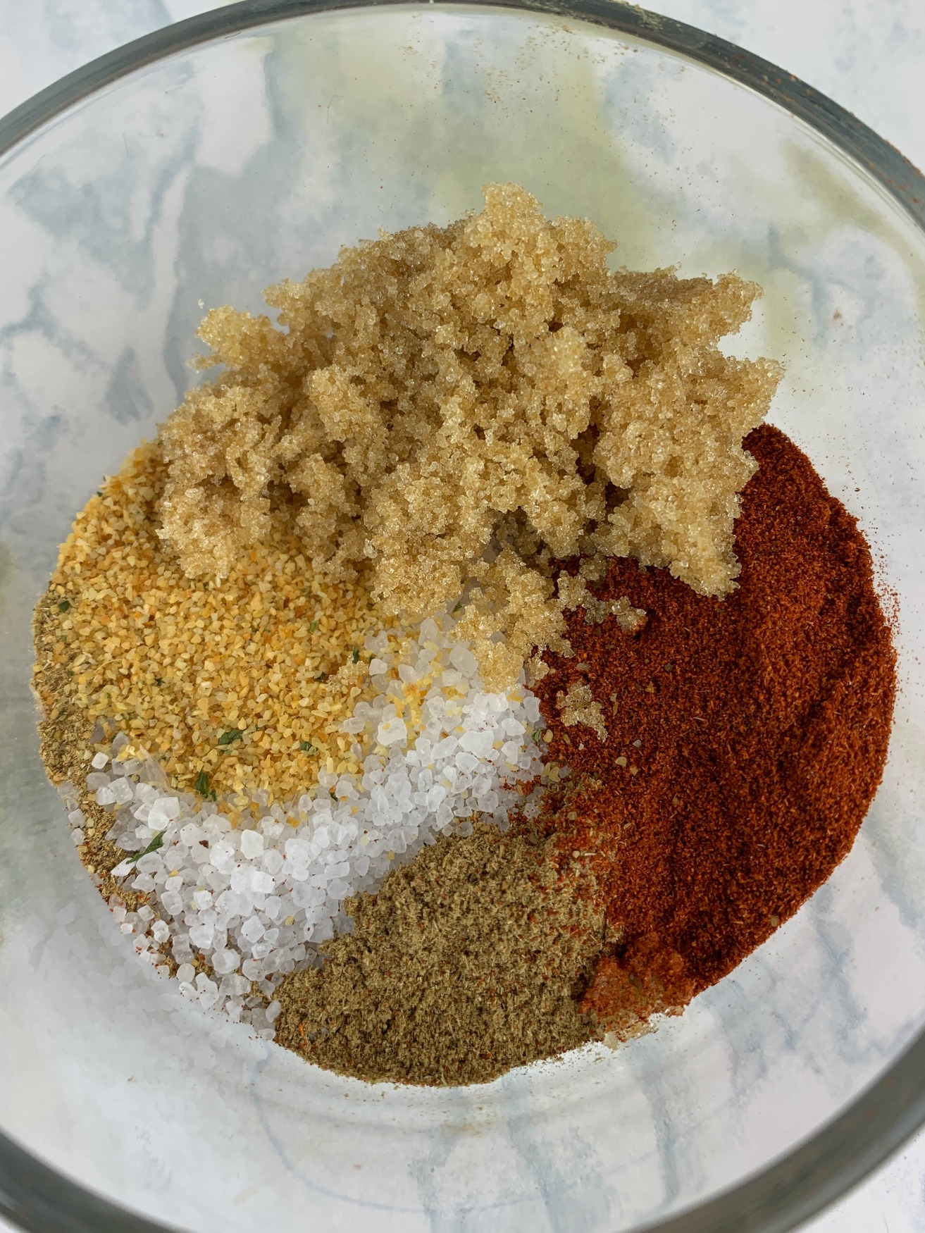 glass bowl filled with spices before mixing